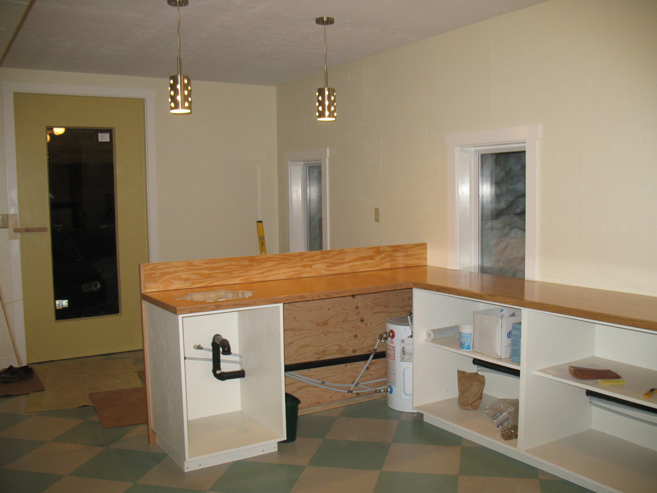 Counters, plumbing, new window in front door: all coming along at breakneck speed.