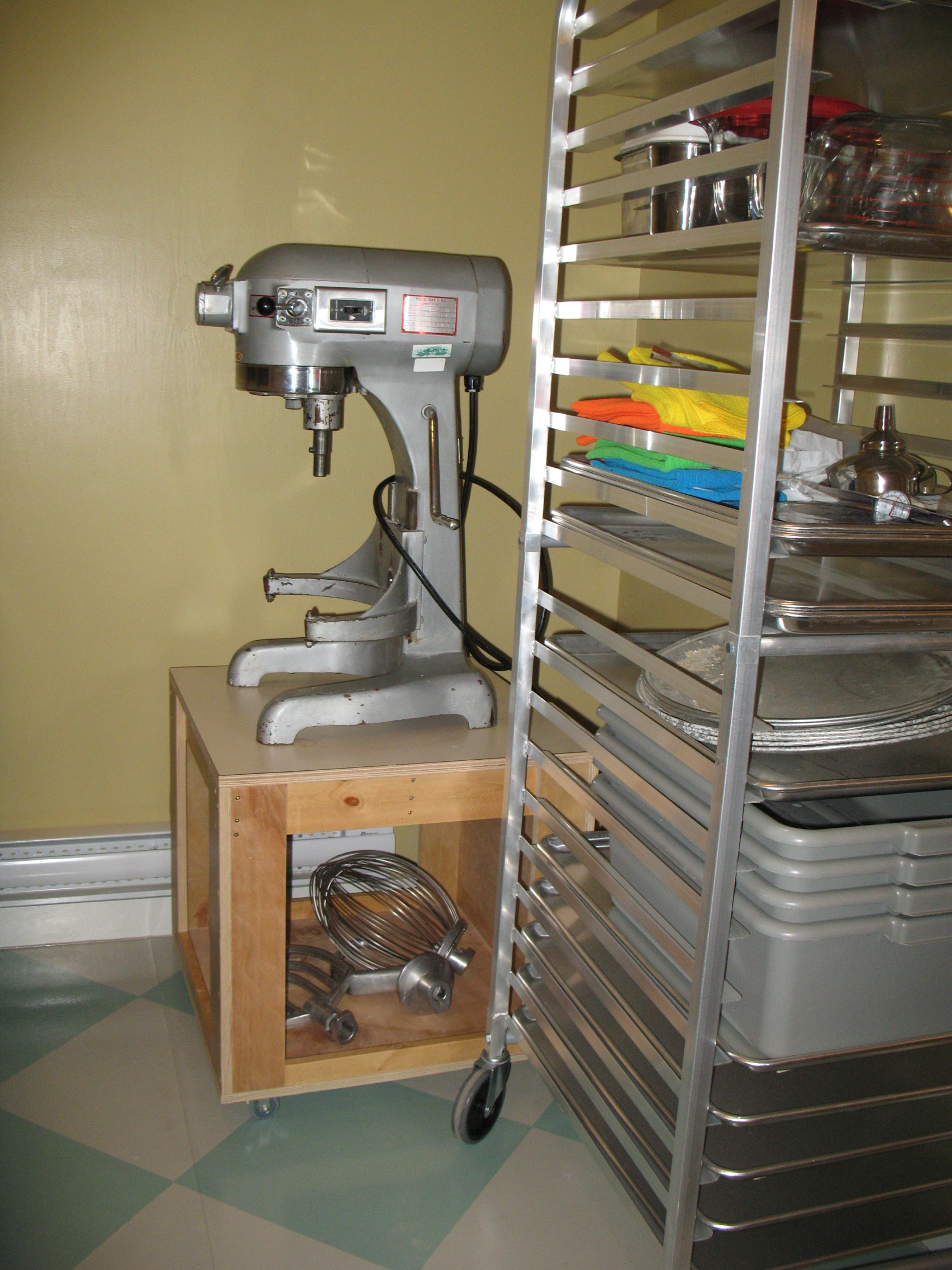 The mixer and the proofing racks in the dough room.