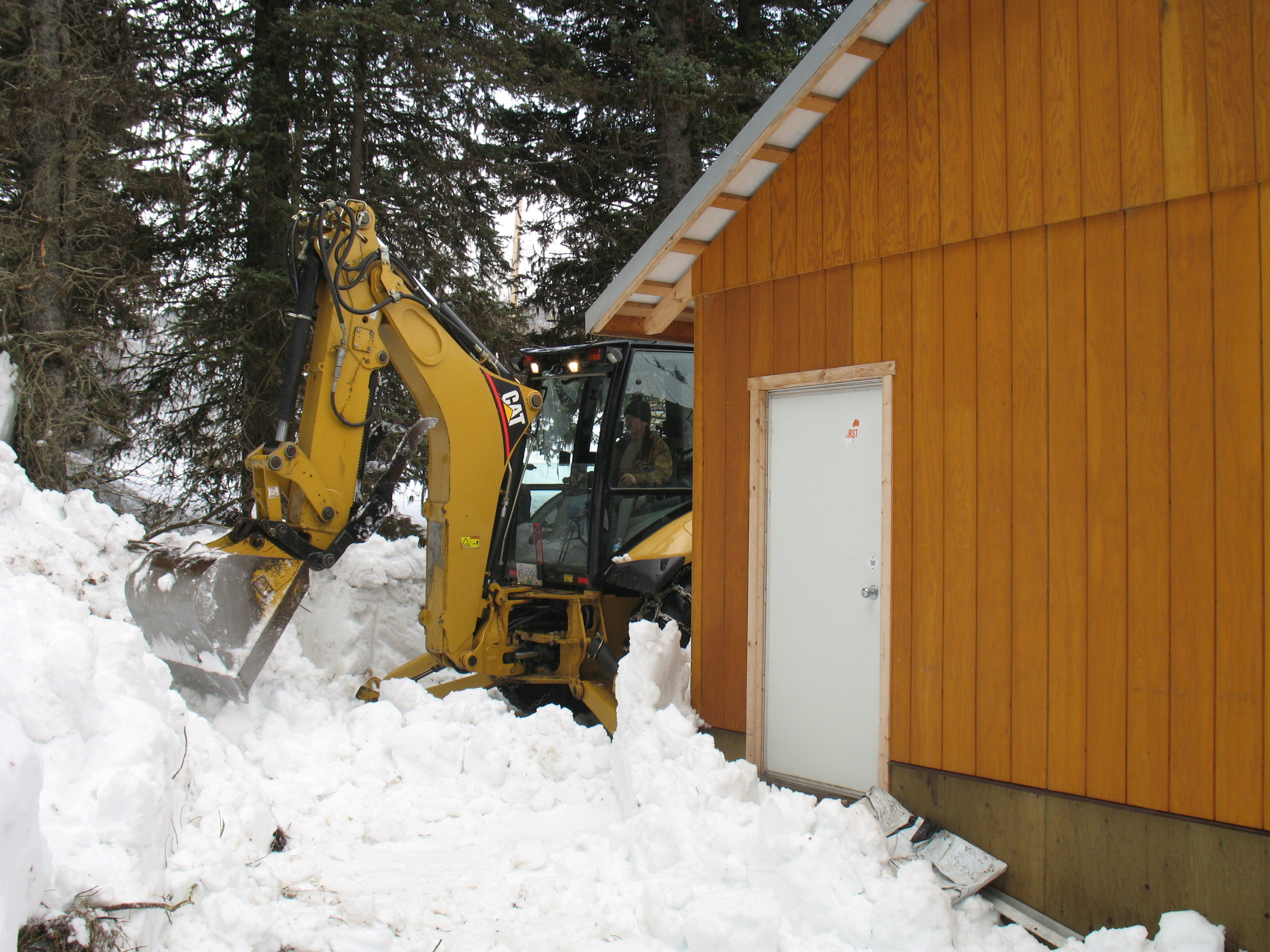 Finally getting around to the back of the building - we will store firewood outside this back door.