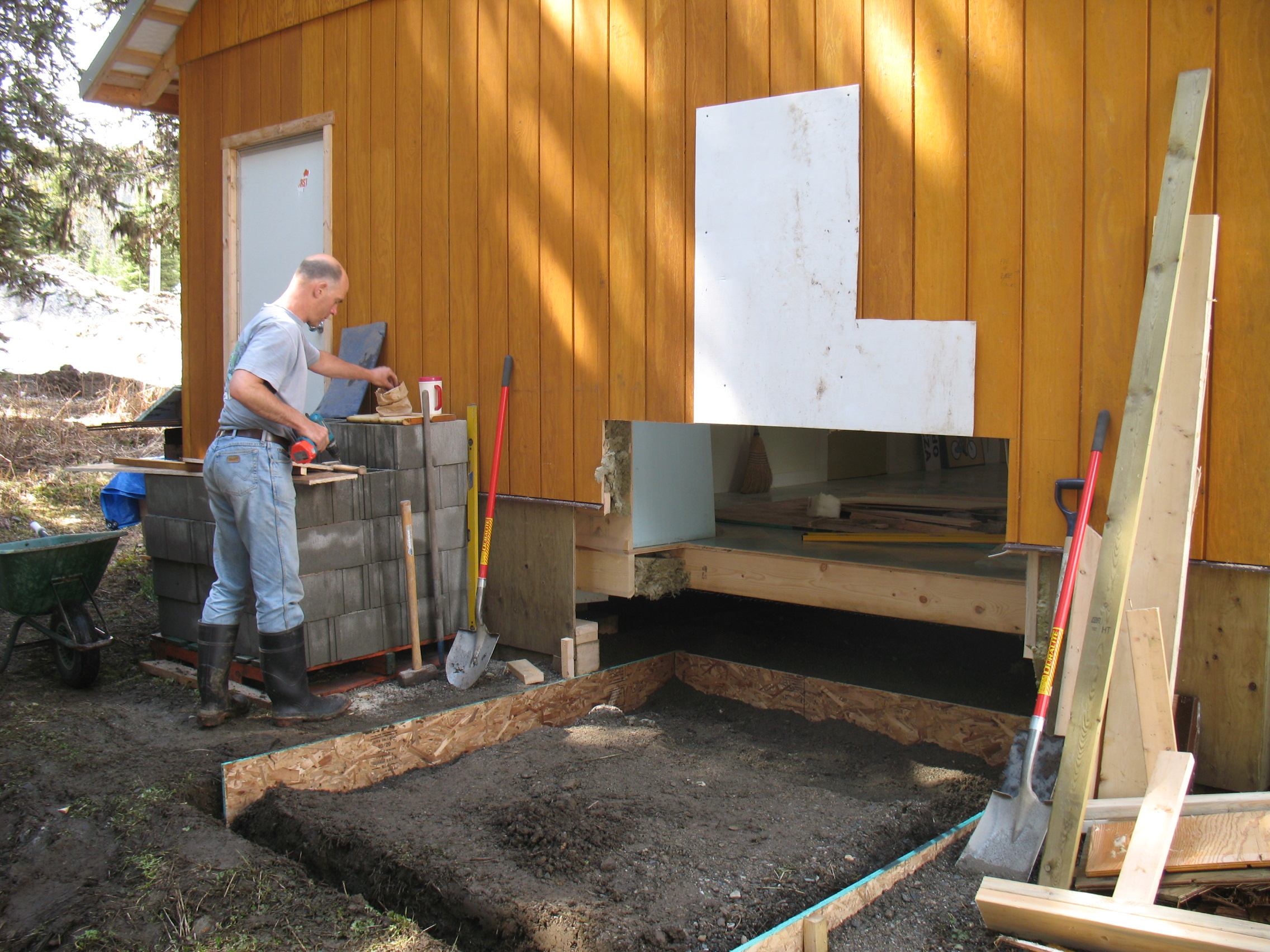 From the outside: preparing the ground for the concrete pad that the oven will sit on.
