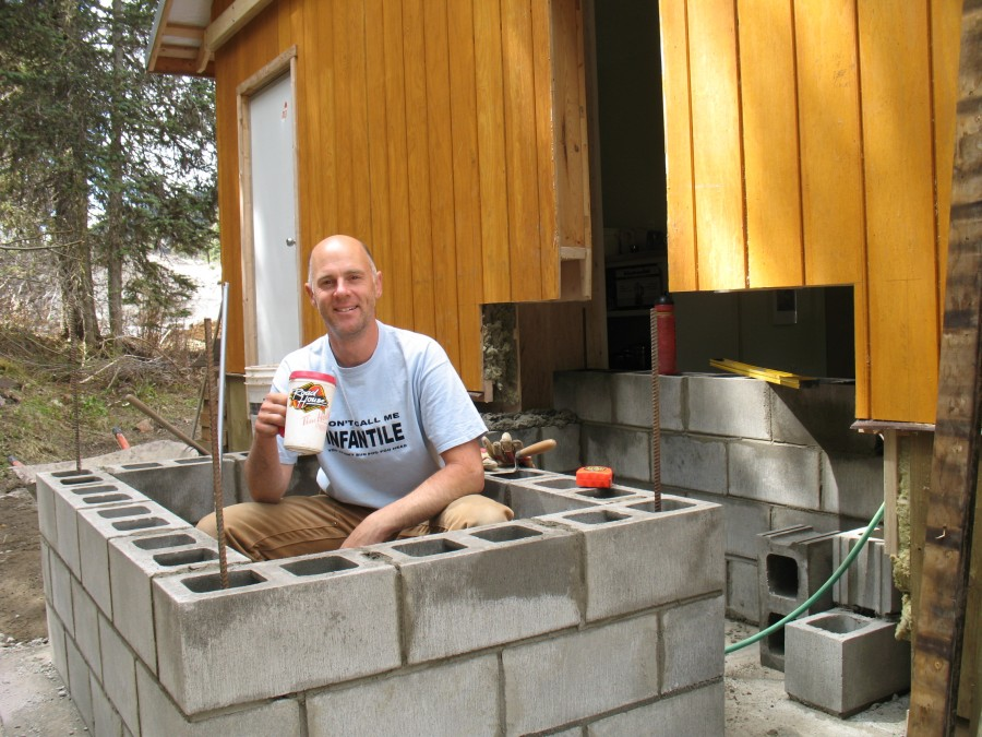 Tim and the first few layers of the concrete block plinth. Is he working or just drinking tea?