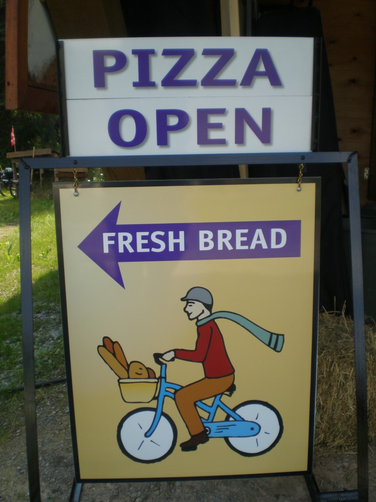 The Bread Peddler's roadside reminder for Tuesday's bread sales and Wednesday's pizza nights.