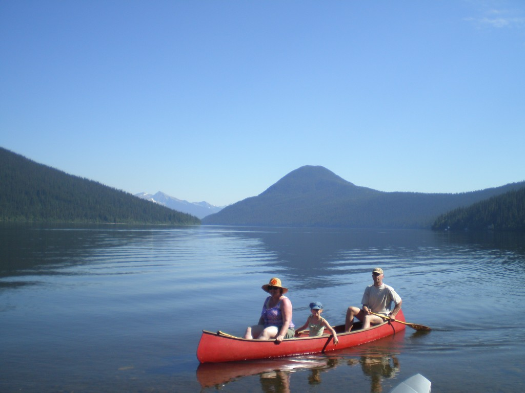 Paddling on beautiful Bowron Lake.