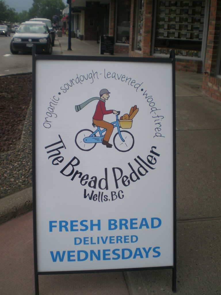 Sandwich board sign outside of Green Tree Health & Wellness, Quesnel.