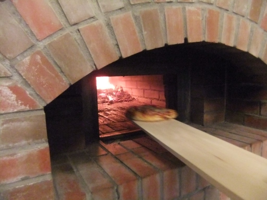 Pizzas come out of the oven after 3-4 minutes of cooking at 700 degrees F (.