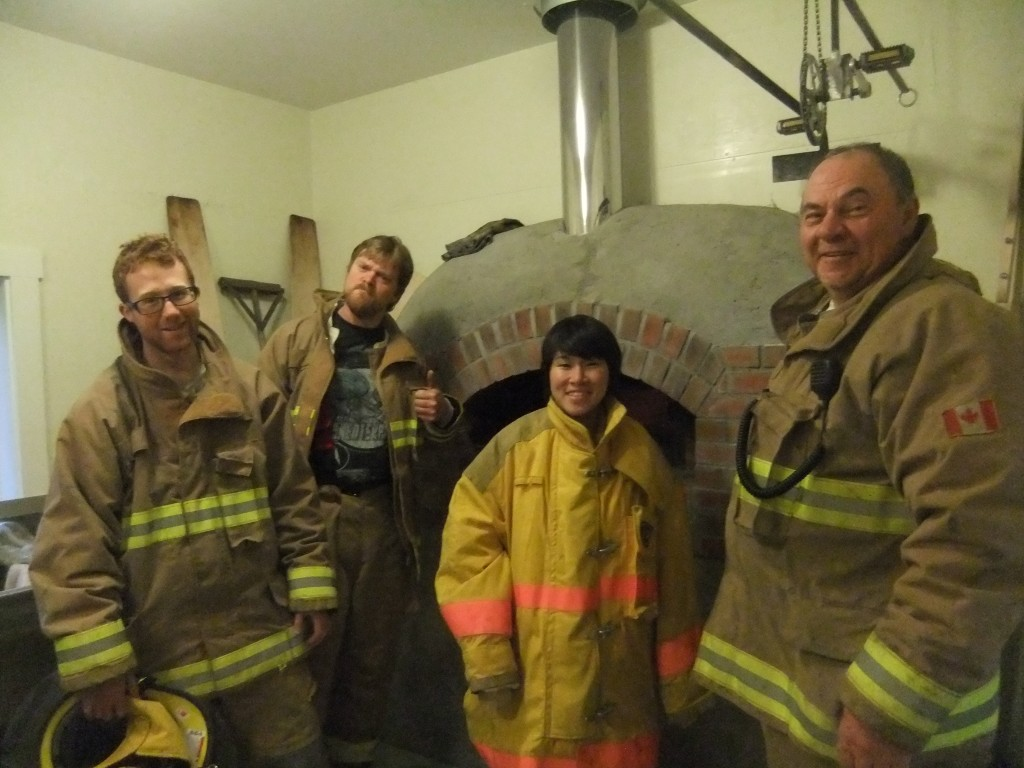 A contingent of the Wells Volunteer Fire Department inspects The Bread Peddler's oven.