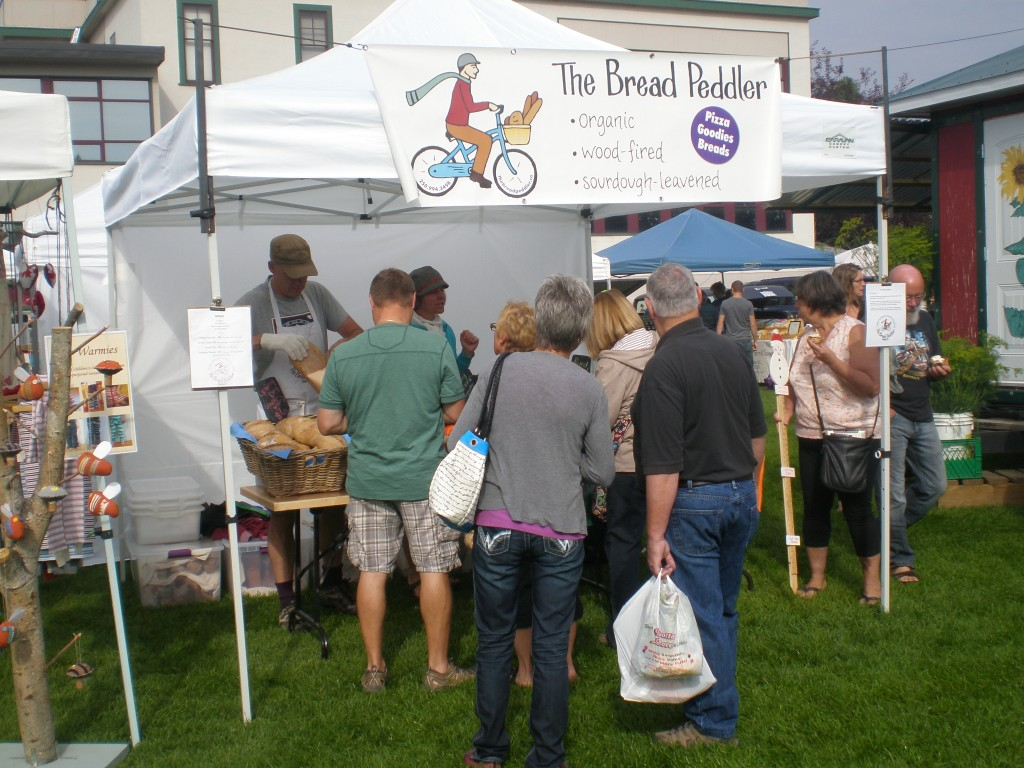 Queuing for great bread at the Quesnel Farmer's Market.