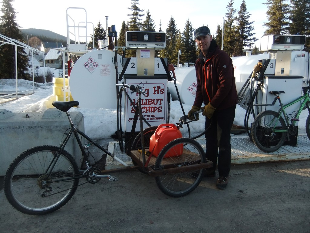 Tim's cargo bike doubling up as a fuel truck: on our way to deliver fuel to a friend's generator, which is keeping her furnace going!