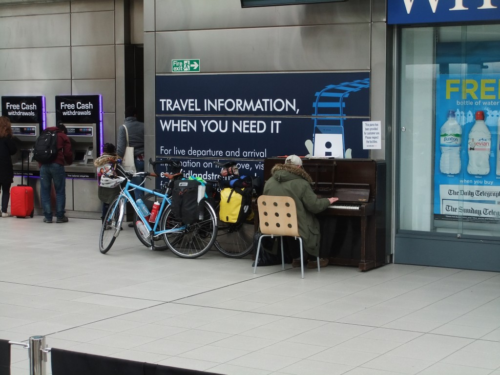 Our bikes being serenaded at the train station in Sheffield.