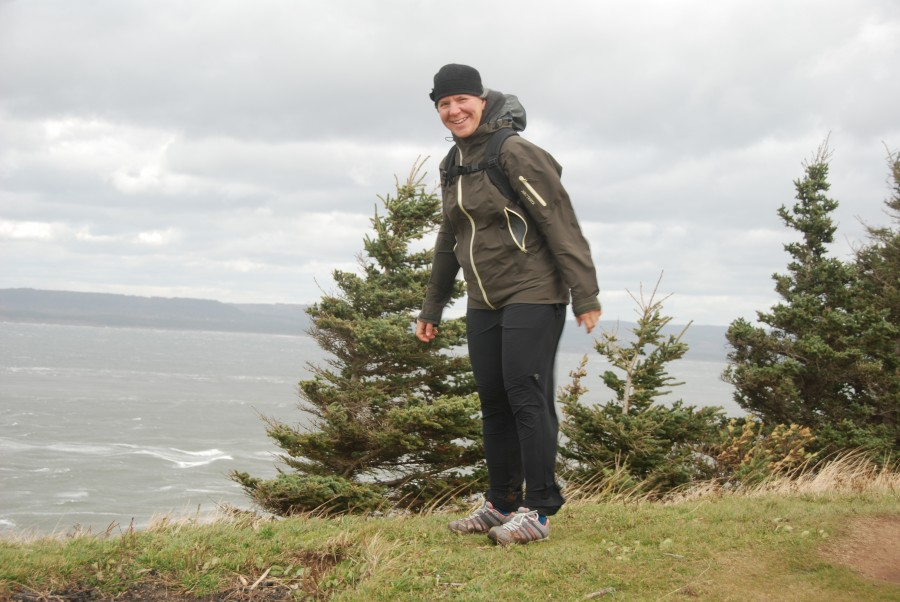 On Cape Split, which pinches off the Bay of Fundy to form the Minas Basin. Home of the highest tides in the world! Trying to stay upright in the VERY strong winds! (My dad had to kneel on the ground to take this photo, and got his feet knocked out from under him as we were trying to retreat from the windy cape).
