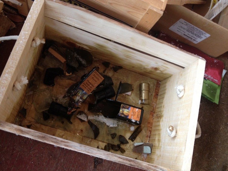 The remains of two lovely bottles of pumpkin seed oil, a bottle of white balsamic vinegar, and one oil and vinegar-stained barn-wood box.