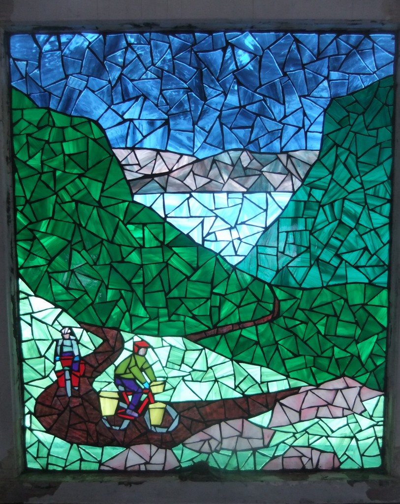 Our new glass mosaic scene - Tim and I riding our loaded bikes up the Bealach na Ba in Scotland (The Pass of the Cattle). Artistic licence allows for me to be in the scene, instead of so far back that you can't see me. Thanks, Beth!