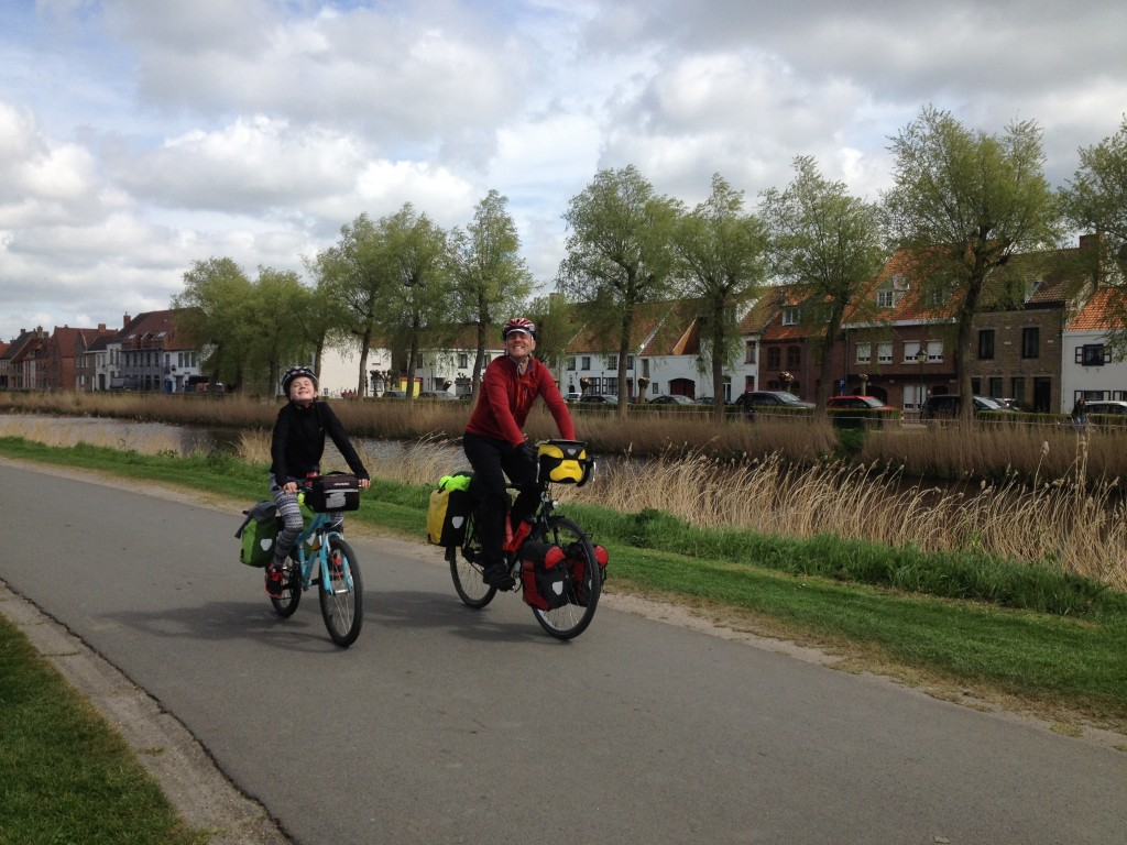 Tim and Sally showing off one of the Netherlands' fine cycling paths alongside a canal.
